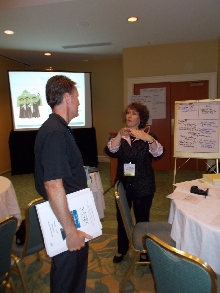 Christy Tull talks to participants after her session about Measuring Judicial Branch Education\'s Impact