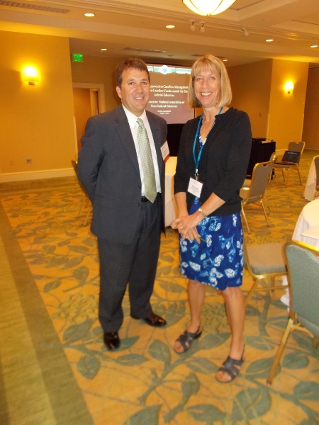 Nancy Smith talks to Phil Knox after his session on Team Approach to Caseflow Management