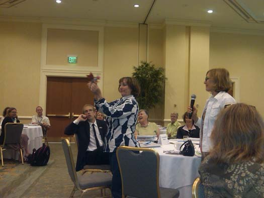 Dottie McDonald and Ann Jordan demonstrate at the closing plenary